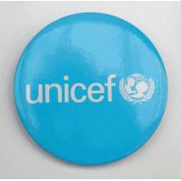 Round UNICEF metal badge, 55 mm diameter
